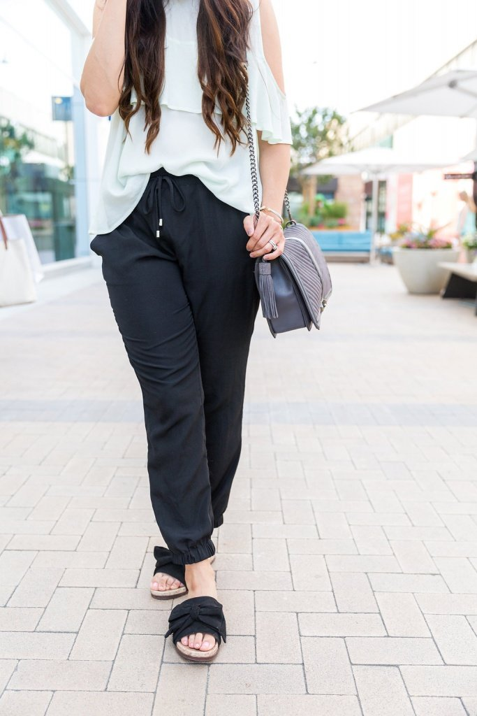 How to wear ruffle tops, how to wear joggers, Tips for styling joggers, could shoulder top outfit, jogger pant outfit, ruffle top outfit spring style